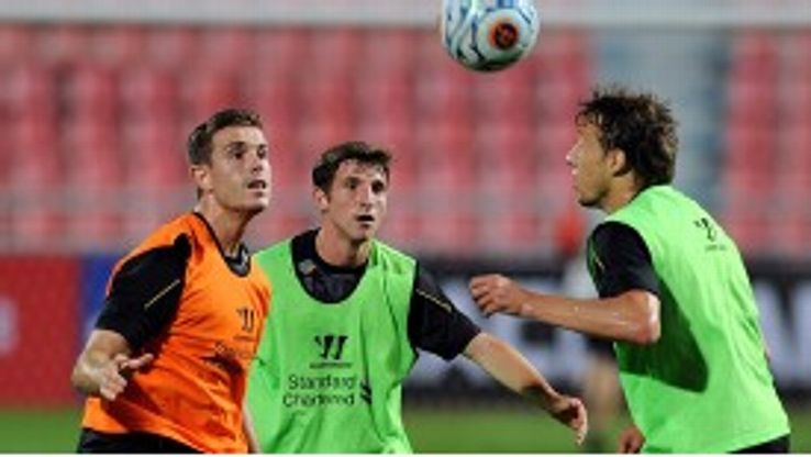 Jordan Henderson (l) and Joe Allen (c) will battle it out for the final place in Liverpool's three-man midfield.