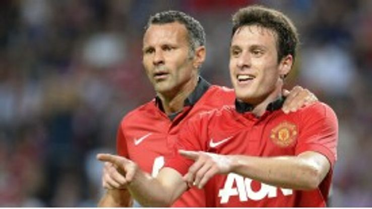 Angelo Henriquez celebrates his strike for Manchester United with Ryan Giggs.