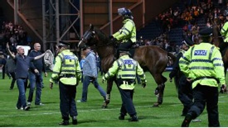 The police used horses to force celebrating Preston fans off the Deepdale pitch but one steward was trampled on