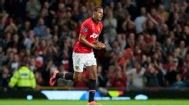 Rio Ferdinand applauds Manchester United fans after being substituted in his testimonial match.