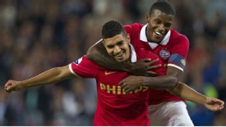 Zakaria Bakkali celebrates after completing his hat-trick for PSV.
