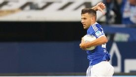Adam Szalai celebrates after his goal earned Schalke a 3-3 home draw with Hamburg