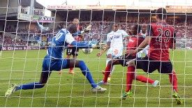 Dimitri Payet scores one of his two goals in Marseille's 3-1 win at Guingamp on Sunday