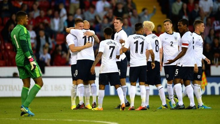Connor Wickham celebrates his goal as dejected Scotland goalkeeper Jordan Archer looks on.