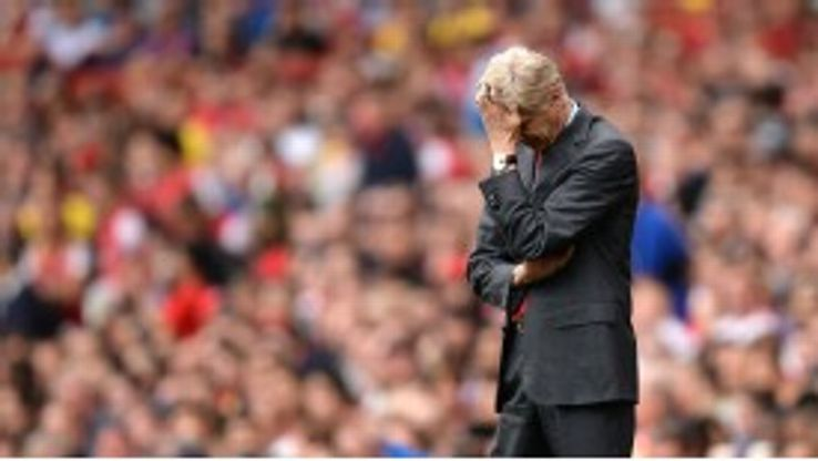 Arsene Wenger can't bear to watch as Arsenal crash against Aston Villa.