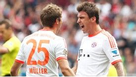 Thomas Muller celebrates with matchwinner Mario Mandzukic