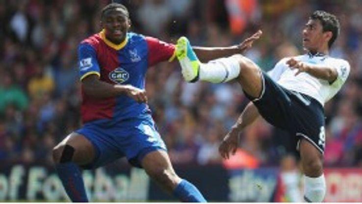 Kagisho Dikgacoi and Paulinho clash.