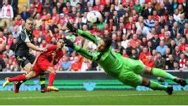 Liverpool Brazilian starlet Philippe Coutinho shoots past Stoke City goalkeeper Asmir Begovic.