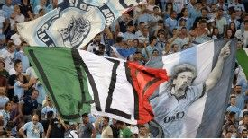 Lazio supporters wave flags during their Supercoppa defeat to Juventus on Sunday.
