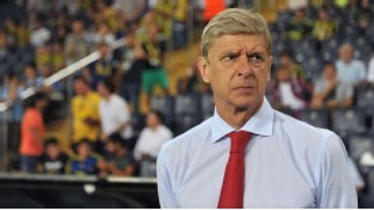 Arsene Wenger watches as Arsenal win 3-0 against Fenerbahce in a Champions League qualifier.