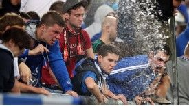 Schalke fans react angrily to police intervention during the game against PAOK Salonika.