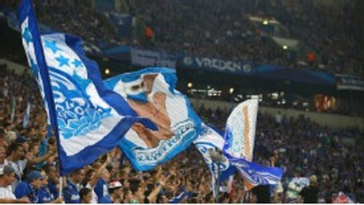 Fans of Schalke wave flags during the Champions League game against PAOK Salonika.