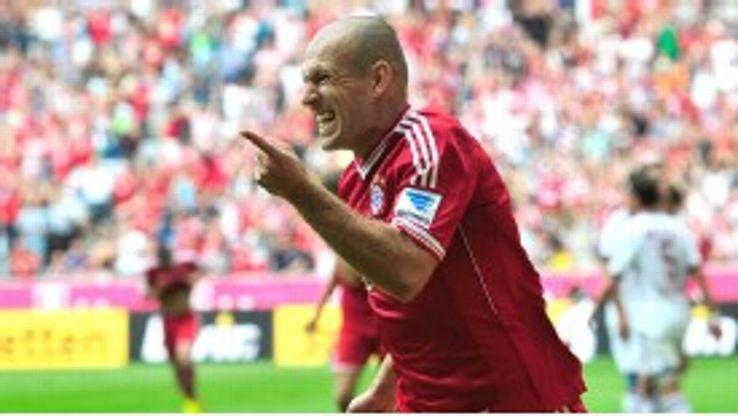 Arjen Robben celebrates after rounding off Bayern Munich's victory over Nurnberg.
