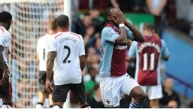 Christian Benteke reacts to a missed chance against Liverpool.