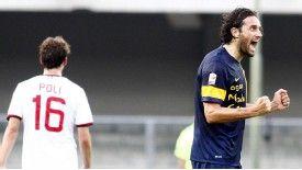 Luca Toni netted a brace to stun AC Milan.