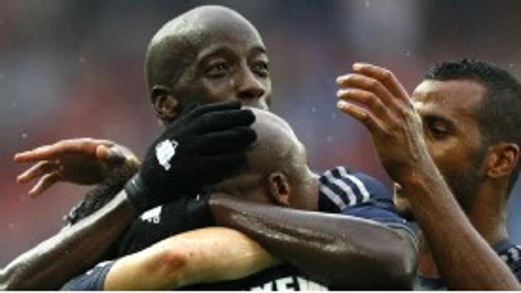 Marseille celebrate their winning goal against Valenciennes on Saturday.