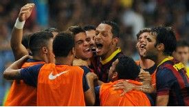 Adriano celebrates with his team-mates after netting the only goal of the game against Malaga.