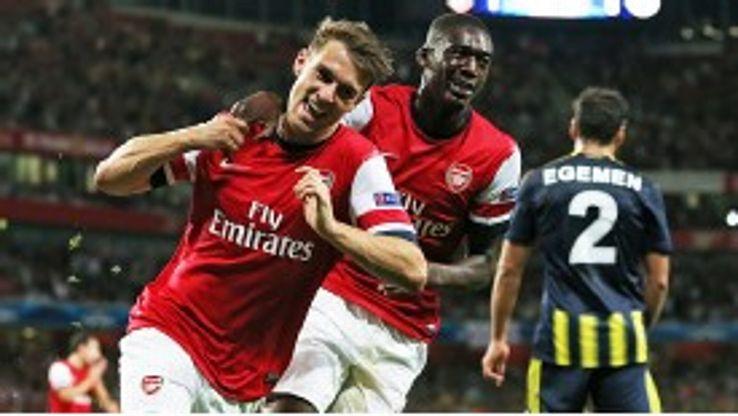Aaron Ramsey celebrates with Yaya Sanogo after scoring a fine second goal.