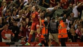 Jordan Henderson celebrates after rounding off what proved to be a testy affair for Liverpool.