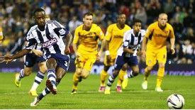 Saido Berahino scores from the spot to complete his hat-trick against Newport County