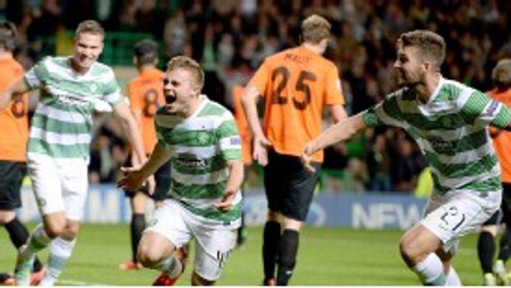 James Forrest celebrates Celtic's dramatic late winner.