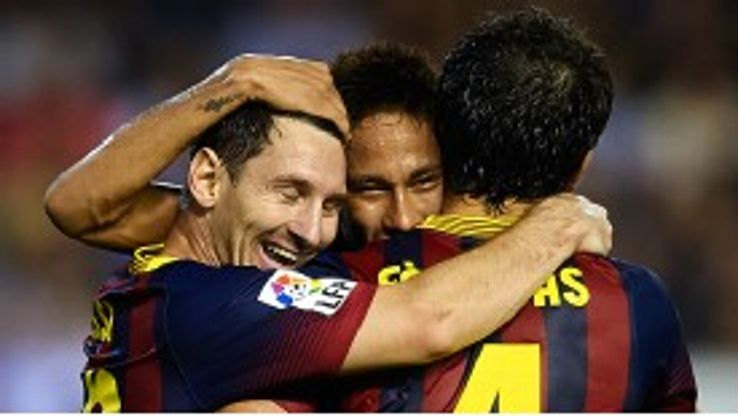Lionel Messi celebrates with his team-mates.