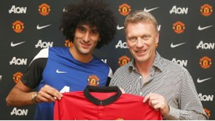 Marouane Fellaini is all smiles as he is reunited with David Moyes at Manchester United