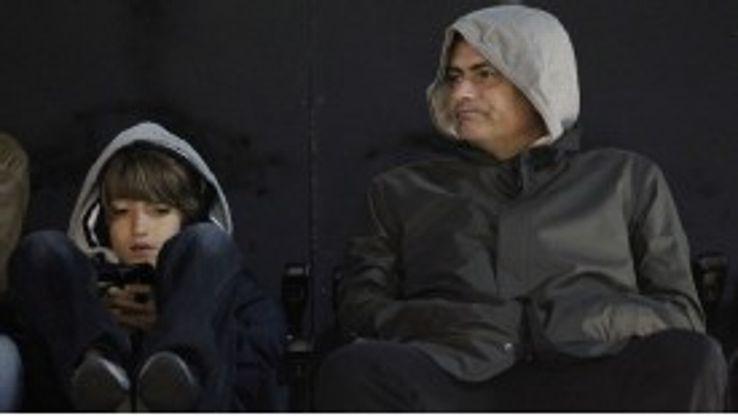 Jose Mourinho and son Jose Mario Mourinho enjoy a match at Crabem Cottage in February 2011.