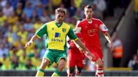 Johan Elmander has joined Norwich on a season-long loan.
