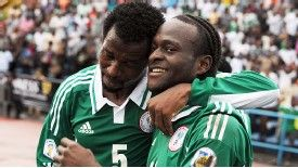 Efe Ambrose and Victor Moses celebrate during the win over Malawi.