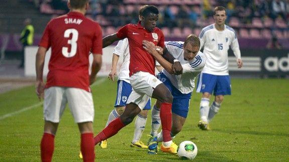 England's Wilfried Zaha battles Finland's Tim Vayrynen in Tampere.