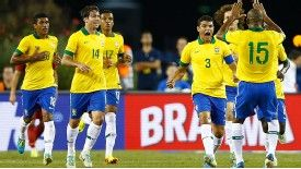 Brazil celebrate Thiago Silva's equaliser.