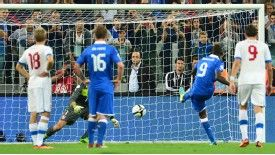 Mario Balotelli completed Italy's comeback with his customary converted penalty, securing qualification.