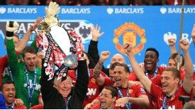 Sir Alex Ferguson lifts his final Premier League trophy.