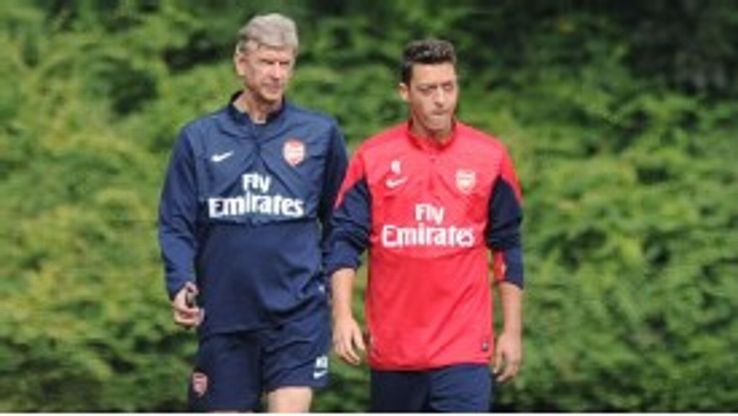 Ozil was accompanied by Wenger to his first Arsenal press conference.