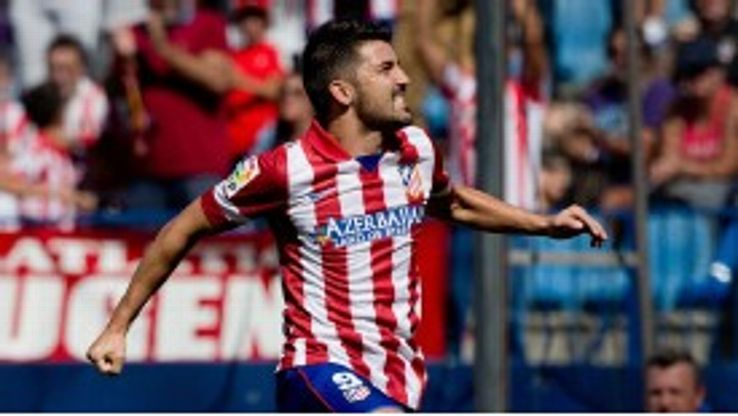 David Villa celebrates after opening the scoring for Atletico.