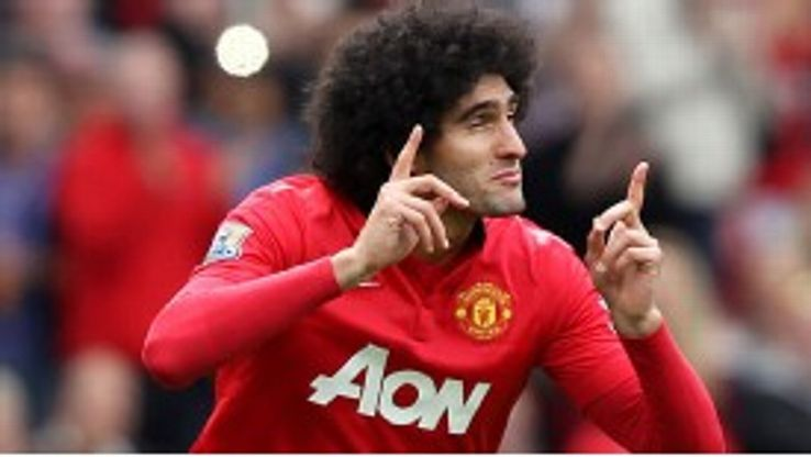 Marouane Fellaini gestures to the Man Utd fans when coming on for his debut.
