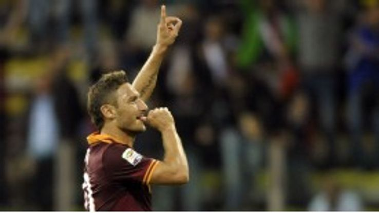Francesco Totti celebrates his goal for Roma against Parma.
