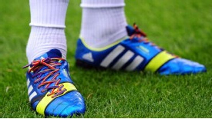 QPR midfielder Joey Barton models rainbow laces in support of the Right Behind Gay Footballers campaign.