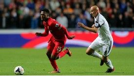 Daniel Sturridge evades Jonjo Shelvey during the stalemate in Wales.