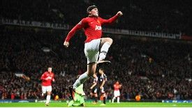 Wayne Rooney jumps for joy after netting his second against Leverkusen.