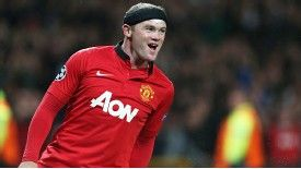 Wayne Rooney celebrates after firing Man United in front at home to Bayer Leverkusen