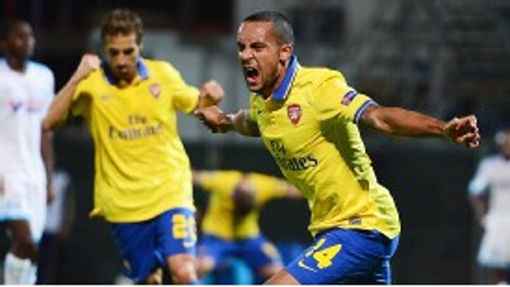 Theo Walcott celebrates after putting Arsenal in front at Marseille.