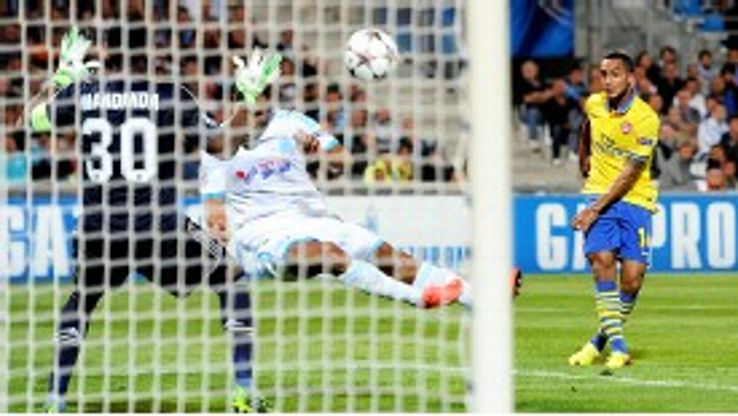 Theo Walcott's fine volley put Arsenal in front at Marseille.