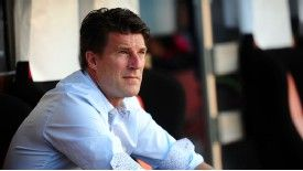 Michael Laudrup sits in the dugout at the Mestalla.