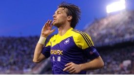 Michu celebrates after putting Swansea 2-0 up at Valencia.