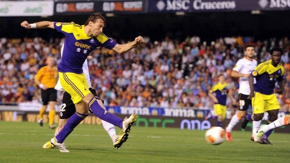 Michu fires home Swansea's second goal in the victory over Valencia.