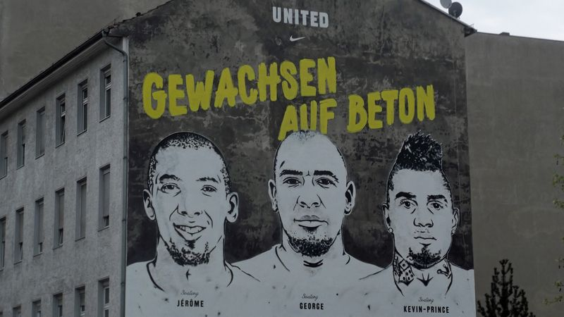 A mural in Berlin depicting Kevin-Prince and Jerome alongside their older brother George.