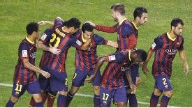 Pedro is mobbed after scoring against Rayo Vallecano.