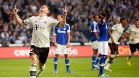 Bastian Schweinsteiger celebrates after scoring Bayern's first goal at Schalke.